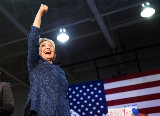 Democratic presidential candidate, Hillary Clinton gestures to the crowd as she takes the stage for a campaign event at Miles College Saturday, Feb. 27, 2016, in Fairfield, Ala.