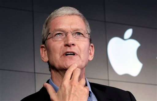FILE - In this April 30, 2015 file photo, Apple CEO Tim Cook responds to a question during a news conference at IBM Watson headquarters, in New York.