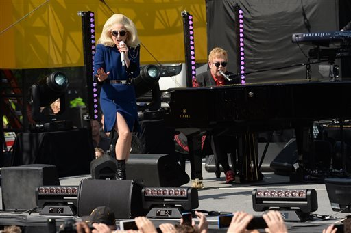 Lady Gaga, left, and Elton John perform on the Sunset Strip for an event co-presented by AOL BUILD and BBVA Compass on Saturday, Feb. 27, 2016, in West Hollywood, Calif.