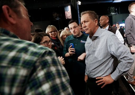 Republican presidential candidate Ohio Gov. John Kasich listens to supports after speaking at a rally Saturday, Feb. 27, 2016, in Nashville, Tenn. (AP Photo/Mark Humphrey)