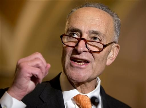 In this Oct. 20, 2015, file photo, Sen. Charles Schumer, D-N.Y. talks to media on Capitol Hill in Washington. Schumer wants to require the Federal Aviation Administration to establish seat-size standards for commercial airlines, which he says now force pa