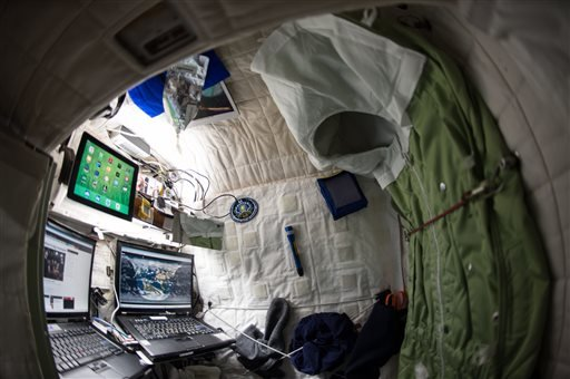 This April 24, 2015 photo provided by NASA shows astronaut Scott Kelly's personal living quarters on the International Space Station. Kelly sees his nearly completed one-year mission as a 'steppingstone' to Mars. America's record-breaking astronaut will s