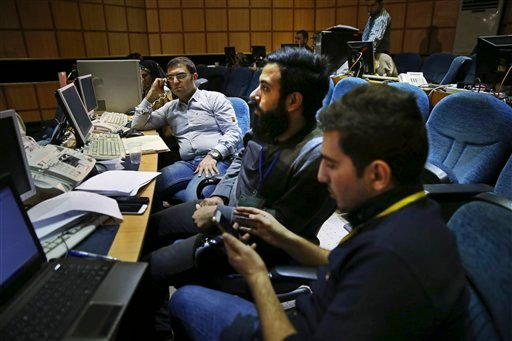 Iranian journalists follow the preliminary results of parliamentary and Experts Assembly elections at the Interior Ministry, in Tehran, Iran, Saturday, Feb. 27, 2016. Preliminary results early Saturday morning showed reformist candidates heading for their