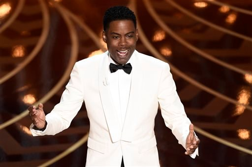 Host Chris Rock speaks at the Oscars on Sunday, Feb. 28, 2016, at the Dolby Theatre in Los Angeles. (Photo by Chris Pizzello/Invision/AP)