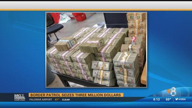 two men arrested and  3 million in cash seized in