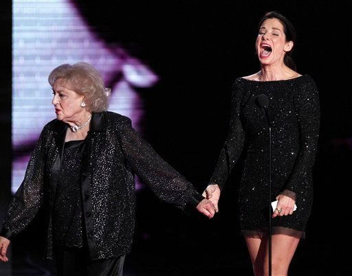 Betty White, left, is seen with Sandra Bullock during the presentation of the MTV Generation award at the MTV Movie Awards in Universal City, Calif., on Sunday, June 6, 2010. (AP Photo/Matt Sayles)