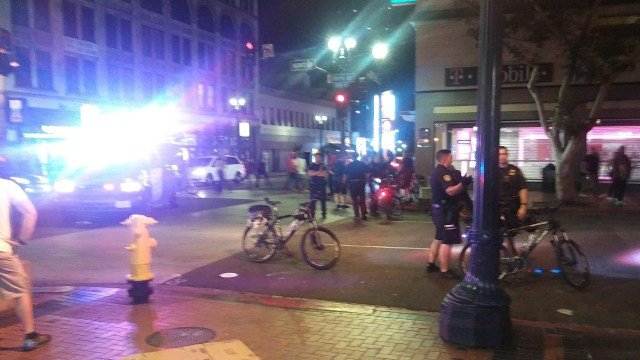 SAN DIEGO (CNS) - A man was caught in crossfire when gunshots erupted outside a nightclub in San Diego's Gaslamp district, police said Sunday.