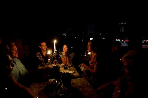 15422811 BG5 People talk around candles in front of the bar Voyeur in the Gaslamp ...