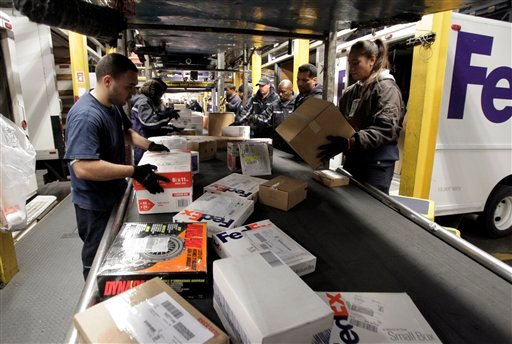 ups fedex holiday package volume up from 2010 cbs news