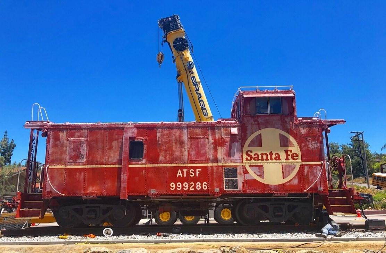 all aboard  train caboose pulls into fallbrook