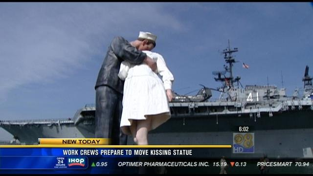 Work crews begin removing kissing statue near uss midway for Worldwide motors san diego ca