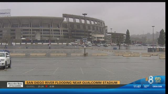 Crews clean up flooded qualcomm parking lot cbs news 8 for Worldwide motors san diego ca