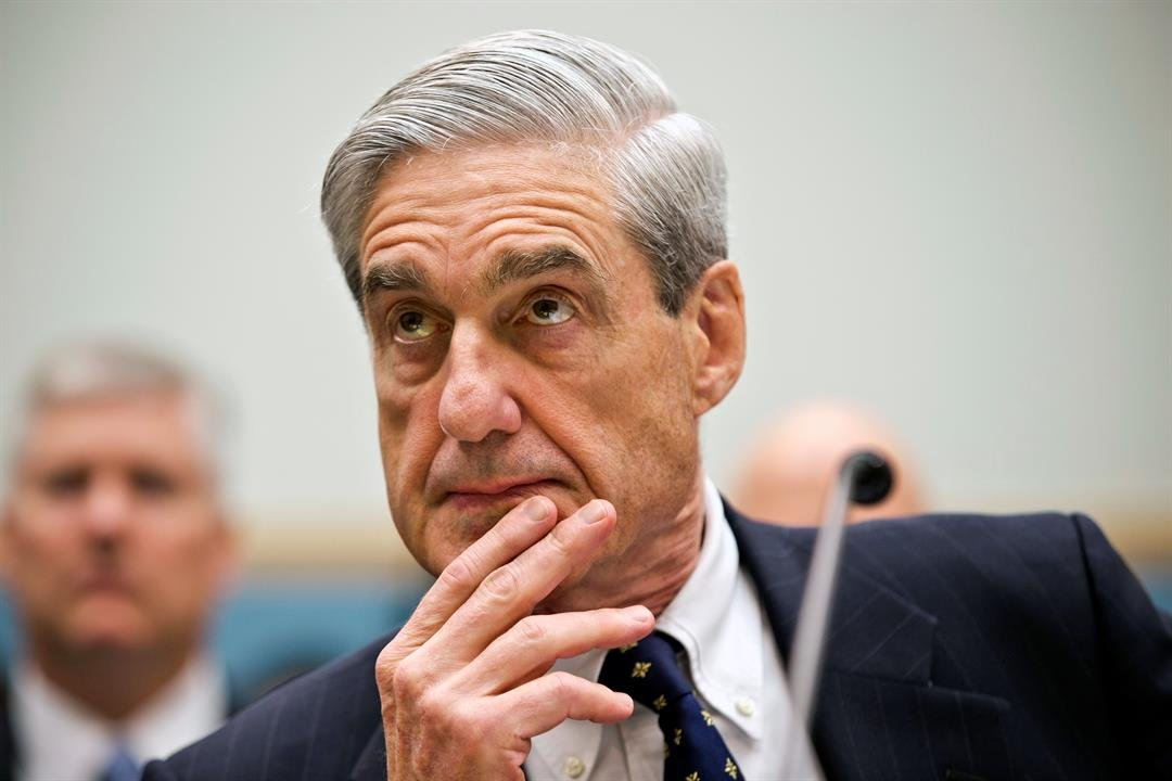 FILE - In this June 13, 2013 file photo, FBI Director Robert Mueller listens as he testifies on Capitol Hill in Washington, as the House Judiciary Committee held an oversight hearing on the FBI. (AP Photo/J. Scott Applewhite)