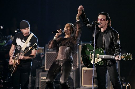 Bono and The Edge, left, from the group U2 perform with Mary J. Blige at the 48th Annual Grammy Awards on Wednesday, Feb. 8, 2006, in Los Angeles. (AP Photo/Mark J. Terrill)