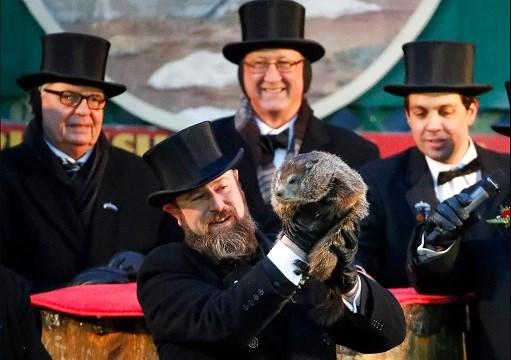 Groundhog Club co-handler Al Dereume holds Punxsutawney Phil, the weather prognosticating groundhog, during the 132nd celebration of Groundhog Day on Gobbler's Knob in Punxsutawney, Pa.