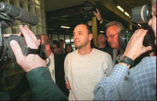 Andrew Urdiales, 32, is shown in custody Friday, April 25, 1997, at Area 2 police headquarters in Chicago. The former Marine is being investigated in as many as eight killings in Illinois and California. (AP Photo/Chicago Sun-Times, Dom Najolia)