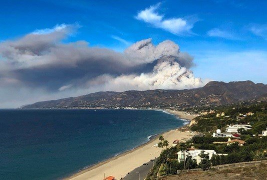 A large plume of smoke from a wildfire near Lake Sherwood can be seen from Malibu, Calif. on Tuesday, Nov. 13, 2018.(AP Photo/Brian Skoloff)