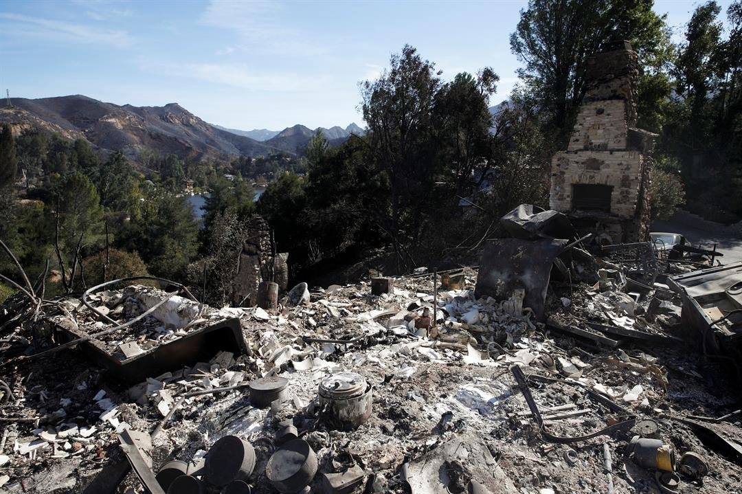 A home burned down by the Woolsey Fire sits on a hilltop overlooking the Santa Monica Mountains, Tuesday, Nov. 13, 2018, in Agoura Hills, Calif. (AP Photo/Jae C. Hong)