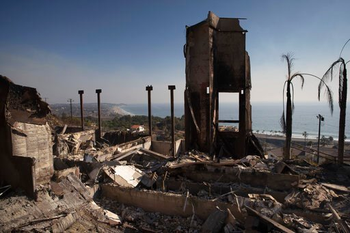 FILE - In this Sunday, Nov. 11, 2018 file photo, a home burned down by a wildfire sits on a hilltop overlooking the Pacific Ocean, in Malibu, Calif. (AP Photo/Jae C. Hong, File)