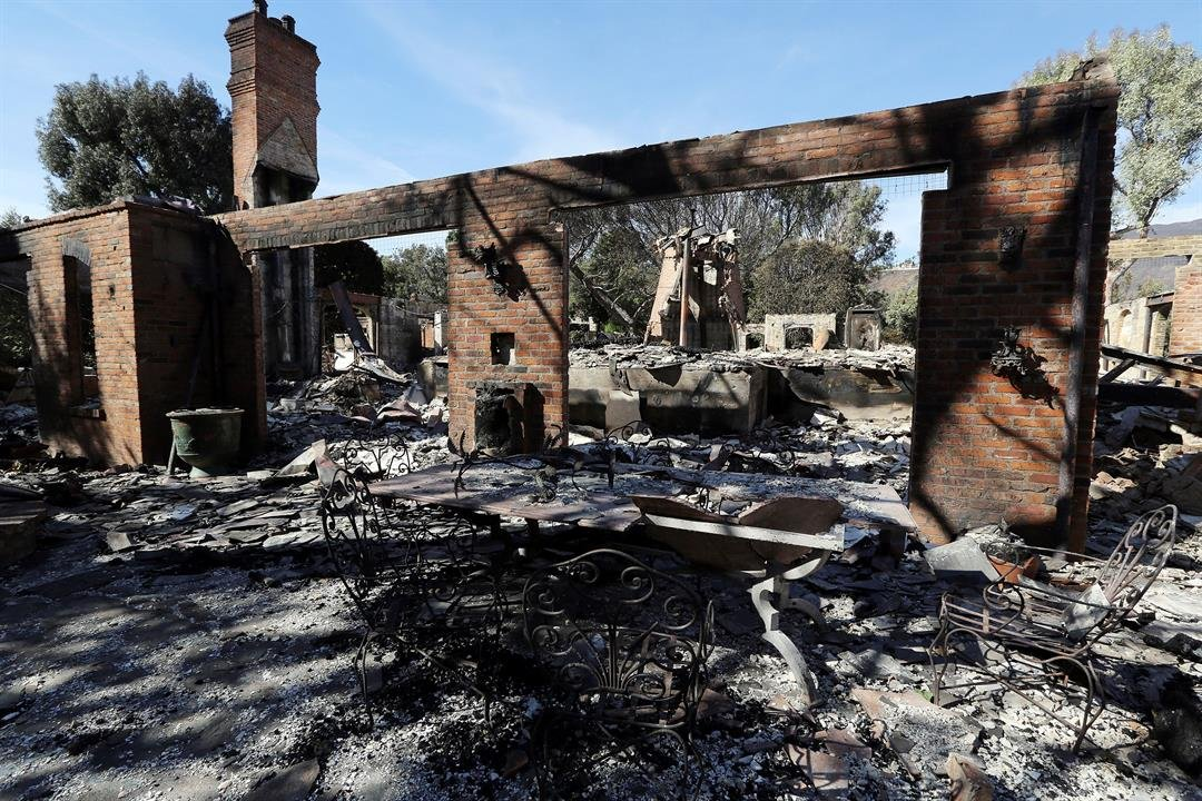Charred remains are all that is left of the destroyed home of German TV presenter Thomas Gottschalk, Tuesday, Nov. 13, 2018, in Malibu, Calif., after the Woolsey Fire swept through. (AP Photo/Reed Saxon)