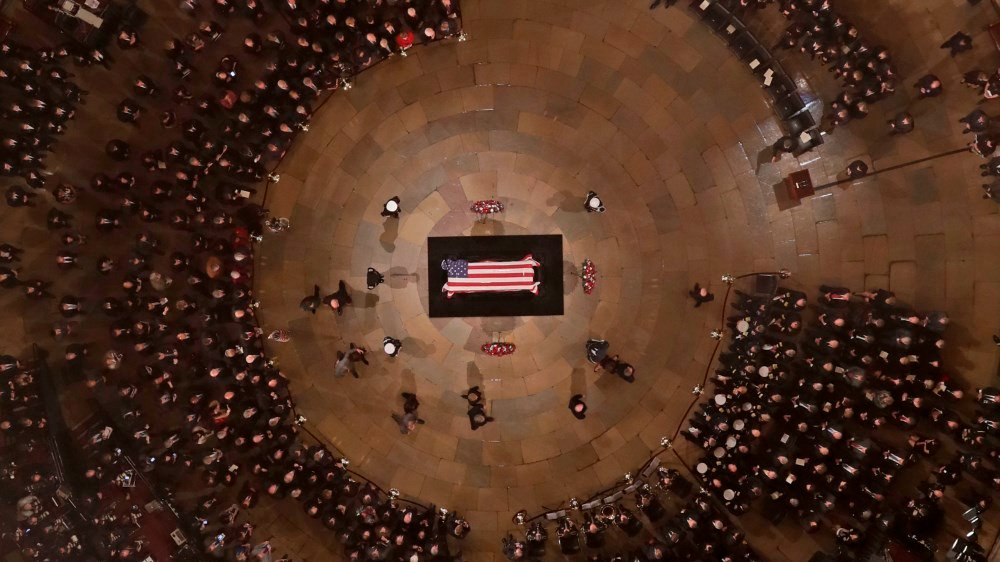 They Bush family walks past the casket of former President George H.W. Bush as he lies in state in the U.S. Capitol Rotunda Monday, Dec. 3, 2018, in Washington. (AP Photo/Morry Gash via AP, Pool)