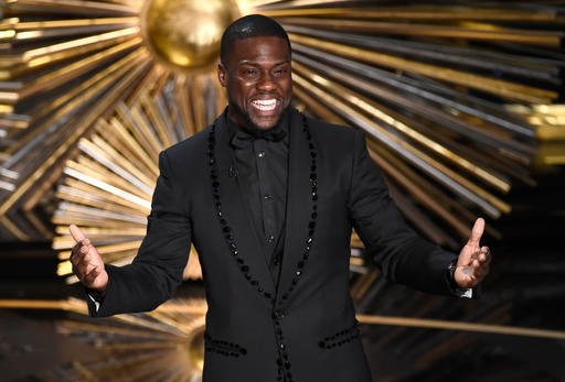 FILE- In this Feb. 28, 2016, file photo, Kevin Hart speaks at the Oscars at the Dolby Theatre in Los Angeles. The newest members of the film academy won't cast their first Oscar ballots until next year, but they already have ideas about who should host th