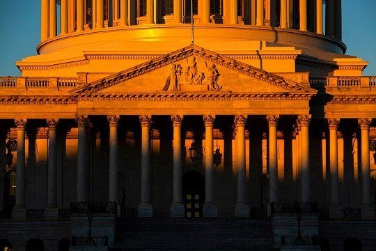 The Capitol is seen at dawn on the 21st day of a partial government shutdown as an impasse continues between President Donald Trump and Democrats over funding his promised wall on the U.S.-Mexico border, in Washington, Friday, Jan. 11, 2019. (AP Photo)