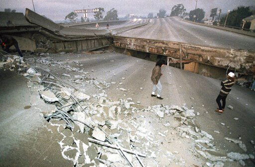 FILE - In this Jan. 17, 1994 file photo, Interstate 10, the Santa Monica Freeway, split and collapsed over La Cienega Boulevard following the Northridge quake in the predawn hours in Los Angeles. (AP Photo/Eric Draper, File)