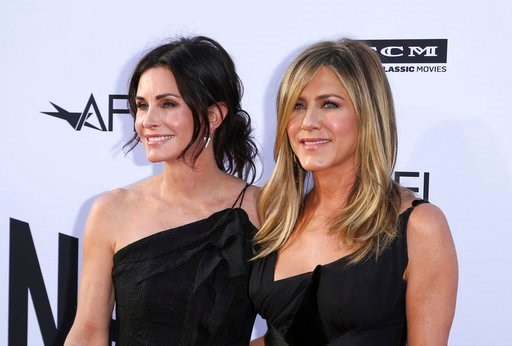 Courteney Cox, left, and Jennifer Aniston arrive at the 46th AFI Life Achievement Award in tribute to George Clooney at Dolby Theater on Thursday, June 7, 2018 in Los Angeles. (Photo by Willy Sanjuan / Invision / AP)
