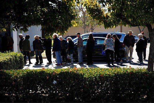 In this Feb. 19, 2019 photo, a group of retired seniors from Laguna Woods Village form a line outside Bud and Bloom cannabis dispensary to attend a presentation organized by cannabis product vendors in Santa Ana, Calif. (AP Photo/Jae C. Hong)