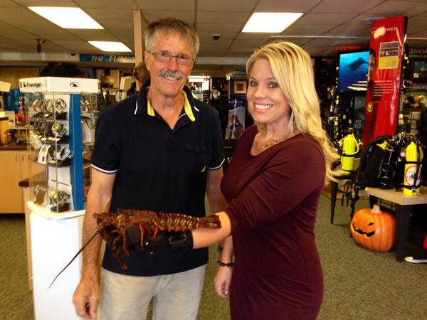 Natasha & Ocean Enterprises owner, Werner Kurn, talking essential dive gear for lobster season.