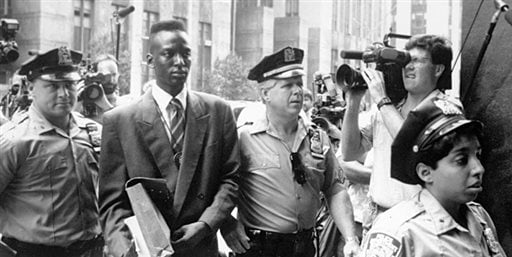 FILE - This 1990 file photo provided by Sundance Selects shows accused rapist Yusef Salaam, second right, being escorted by police in New York in 1990. (AP)