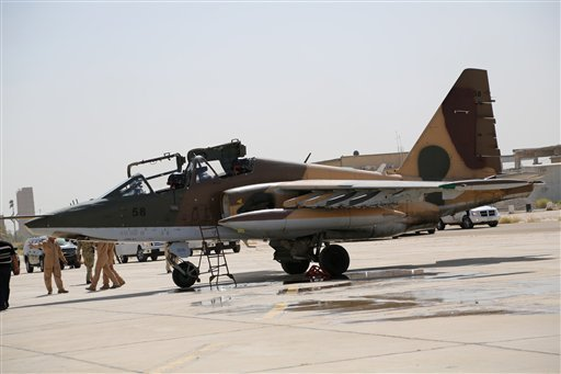 A Russian fighter jet arrives at al-Muthanna air base in Baghdad, Iraq, Tuesday, July 1, 2014. (AP)