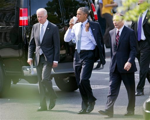 President Barack Obama, center, and Vice President Joe Biden, left, walk with Robert McDonald, Obama's nominee as the next Veterans Affairs secretary, from the Department of Veterans Affairs back to the White House in Washington, Monday, June 30, 2014.