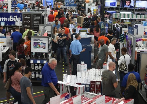 People look at merchandise while holiday shopping at Best Buy on Thursday, Nov. 26, 2015, in Panama City, Fla. (Patti Blake/News Herald via AP)
