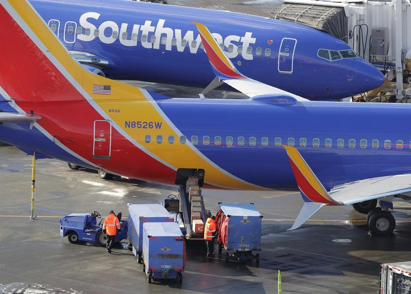Southwest Airlines planes are loaded Tuesday, Feb. 5, 2019, at Seattle-Tacoma International Airport in Seattle. (AP Photo/Ted S. Warren)